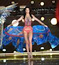 "<p>Making her debit in the first segment of the show, ""Boho Psychedelic,"" Kendall Jenner, whose parents were in the front row, twirled her long silk train like a seasoned pro. </p>"