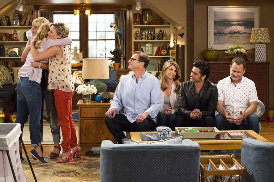 <p>It's hard to type this caption through our tears of joy, but here goes: DJ (Bure), Kimmy (Barber) and Stephanie (Sweetin) hug it out while Danny (Saget), Becky (Loughlin), Uncle Jesse (Stamos) and Joey (Coulier) look on. </p><p><i>(Credit: Netflix)</i></p>