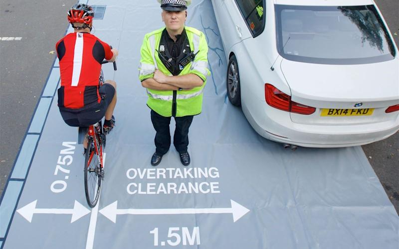 Cycling UK will offer one 'close pass mat' to each police force - West Midlands Police/PA