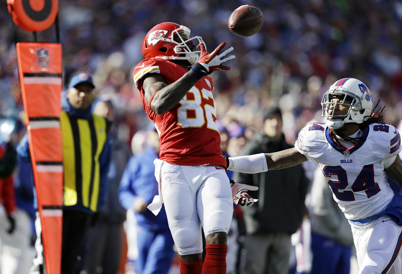 Kansas City Chiefs wide receiver Dwayne Bowe (82) hauls in a pass behind Buffalo Bills cornerback Stephon Gilmore (24) for a 10-yard gain during the second quarter of an NFL football game in Orchard Park, N.Y., Sunday, Nov. 3, 2013. (AP Photo/Bill Wippert)