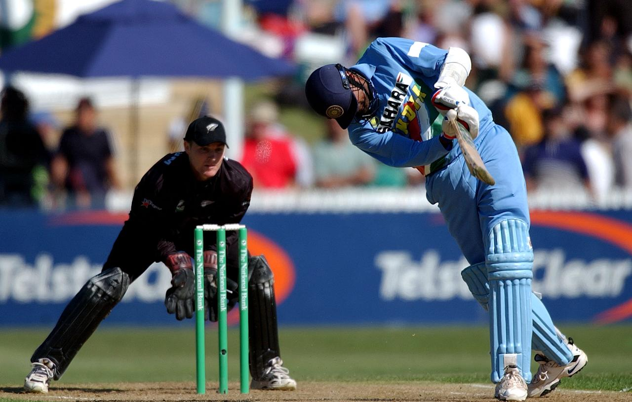 HAMILTON, NEW ZEALAND - JANUARY 14:  India batsman Javagal Srinath hits the ball as New Zealand Keeper Brendon McCullum looks on during the 7th international one day cricket match between New Zealand and India played at Westpack Park, Tuesday. India were all out for 122.  (Photo by Dean Purcell/Getty Images)