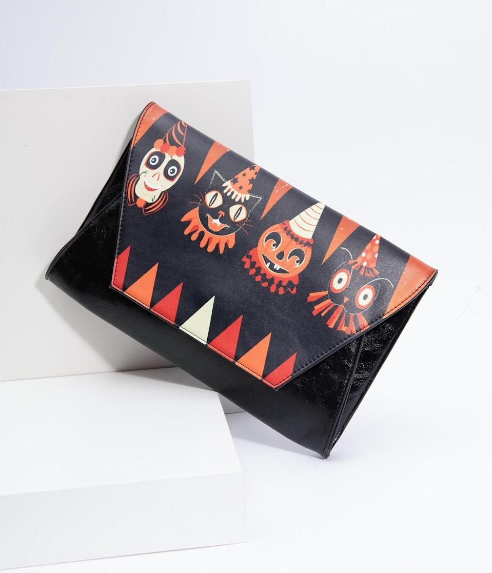 <p>Decorate any outfit with this <span>Black Leatherette Halloween Party Animal Envelope Clutch</span> ($62).</p>