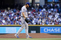 Los Angeles Dodgers starting pitcher Clayton Kershaw flips a new baseball in the air after giving up a home run to Arizona Diamondbacks' Carson Kelly during the second inning of a baseball game Saturday, Sept. 25, 2021, in Phoenix. (AP Photo/Ross D. Franklin)