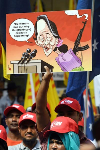 A poster referring to de facto Myanmar leader Aung San Suu Kyi is displayed at a protest during the ASEAN-Australia summit in Sydney