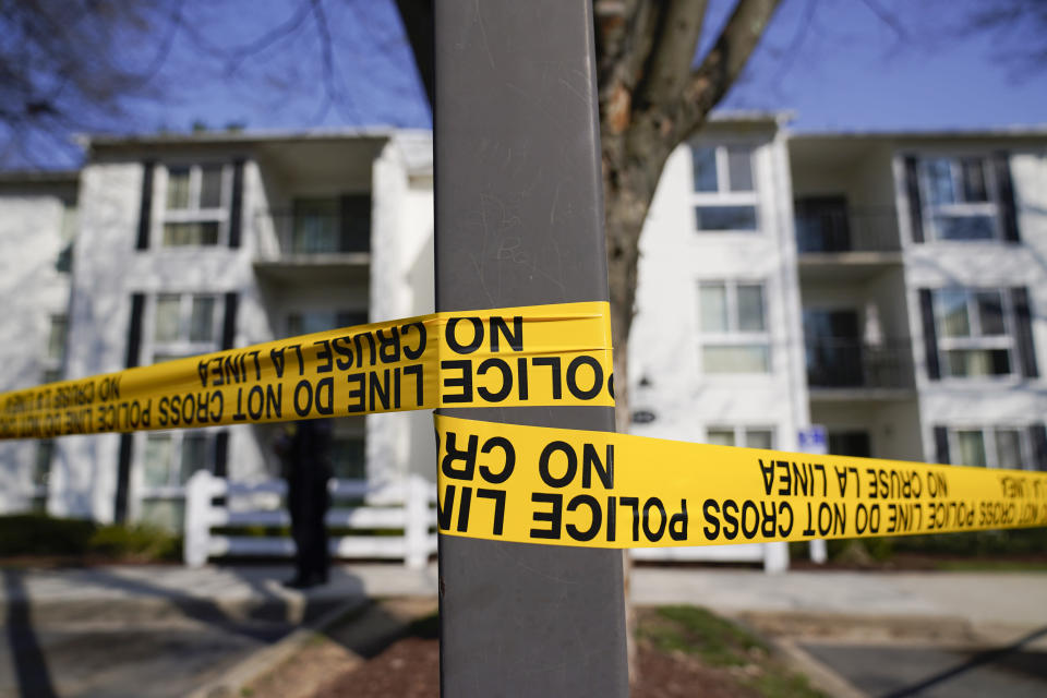 Crime scene tape outside the apartment of Navy Petty Ofc. 3rd Class Fantahun Girma Woldesenbet, assigned to Fort Detrick in Frederick, Md., Tuesday, April 6, 2021. Authorities say the Navy medic shot and wounded two U.S. sailors at a military facility before fleeing to a nearby Army base where security forces shot and killed him. (AP Photo/Carolyn Kaster)