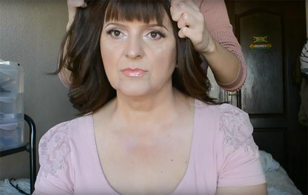 Nadina helps her mother into a wig. Photo: YouTube.