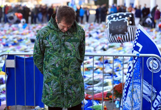 <p>Kasabian singer Tom Meighan pays tribute outside the King Power Stadium. Mike Egerton/PA Wire </p>