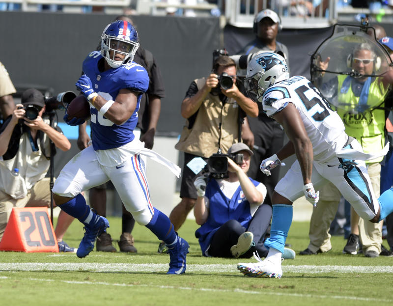 New York Giants' Saquon Barkley has five touchdowns in his first five career games. (AP)