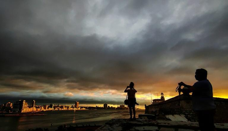 Photographers took pictures of the sunset before the passage of Tropical Storm Elsa in Havana