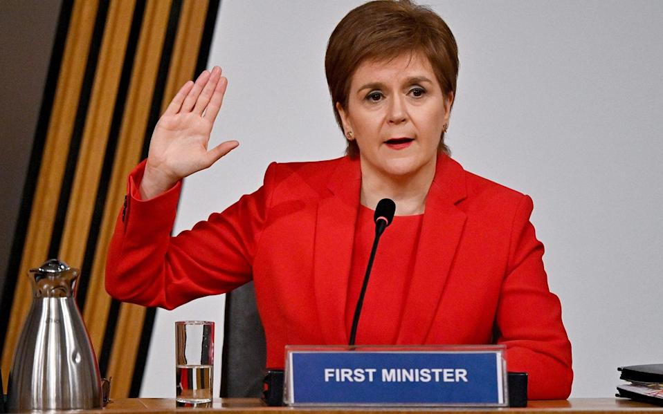 First Minister Nicola Sturgeon taking oath before giving evidence to the Committee on the Scottish Government Handling of Harassment Complaints, at Holyrood - PA