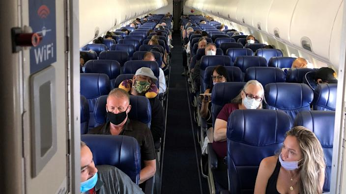 """Masked passengers fill a Southwest Airlines flight from Burbank to Las Vegas on June 3, with middle seats left open. <span class=""""copyright"""">(Christopher Reynolds / Los Angeles Times)</span>"""