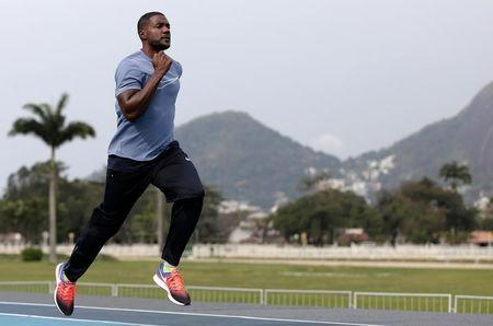 "Gatlin of the U.S. trains ahead of the ""Mano a Mano"" challenge, a 100-meter race, at the Brazilian Jockey Club in Rio de Janeiro"