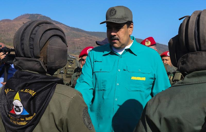 Venezuela's Nicolas Maduro (C) has sought to maintain the loyalty of the military (AFP Photo/Marcelo GARCIA)