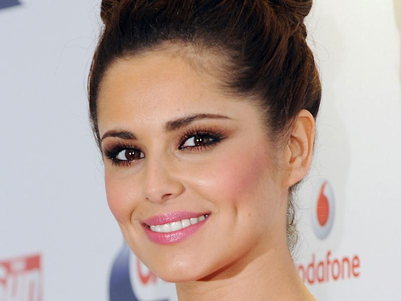 Women have been desperate to possess dimples like Cheryl Cole's: Getty Images