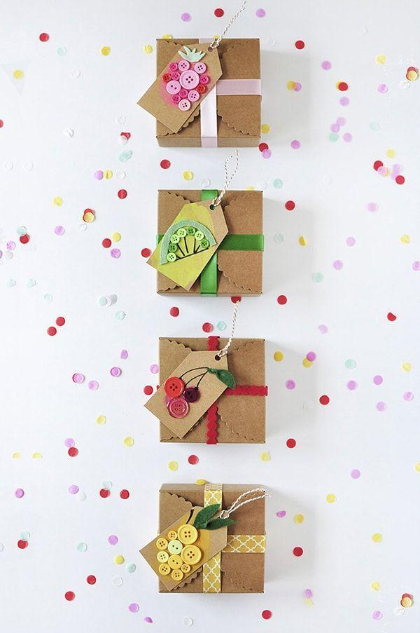 """<p>It's amazing what a few humble craft supplies can do for your gift wrap. Take buttons for example—when arranged just right, you can turn them into adorable fruit-inspired gift tags. </p><p>Get the tutorial at <a href=""""https://www.delineateyourdwelling.com/fruit-gift-tags/"""" rel=""""nofollow noopener"""" target=""""_blank"""" data-ylk=""""slk:Delineate Your Dwelling"""" class=""""link rapid-noclick-resp"""">Delineate Your Dwelling</a>.</p><p> <a class=""""link rapid-noclick-resp"""" href=""""https://www.amazon.com/Assorted-Childrens-Painting-Handmade-Ornament/dp/B076FLR6X1?tag=syn-yahoo-20&ascsubtag=%5Bartid%7C10072.g.34015639%5Bsrc%7Cyahoo-us"""" rel=""""nofollow noopener"""" target=""""_blank"""" data-ylk=""""slk:SHOP BUTTONS"""">SHOP BUTTONS</a></p>"""