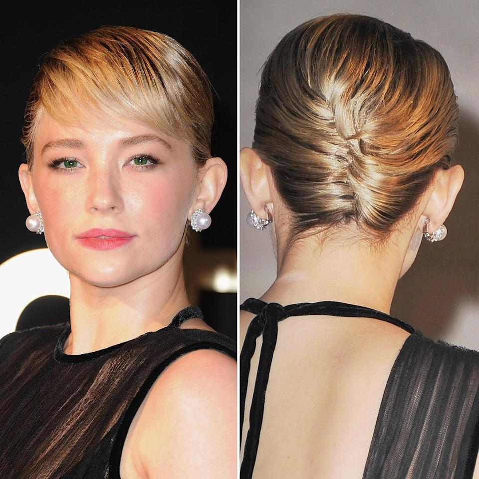 From the front, Haley Bennett's hair looks like a traditional pixie with the bangs combed out straight and pushed slightly to the side. From the back? That's where things get interesting, thanks to a tight little plait made possible by artful pin placement. You could spice this up even more by adding a bejeweled comb.