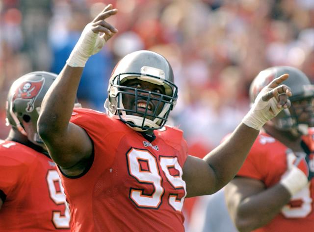FILE - In this Jan. 12, 2003 file photo, Tampa Bay Buccaneers' Warren Sapp tries to get the crowd going in the third quarter of the NFC Divisional playoff against the San Francisco 49ers' in Tampa, Fla. Sapp is a finalist for the Pro Football Hall of Fame, the hall announced Friday, Jan. 11, 2013. (AP Photo/Steve Nesius, File)