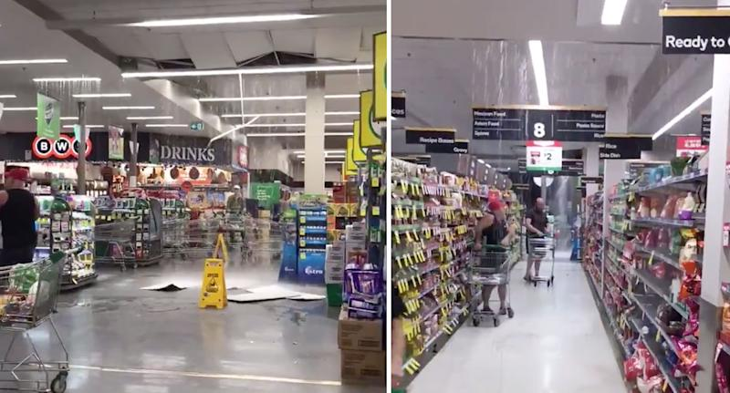 Rain pours from a Woolworths ceiling in Melbourne's Templestowe as customers shop.