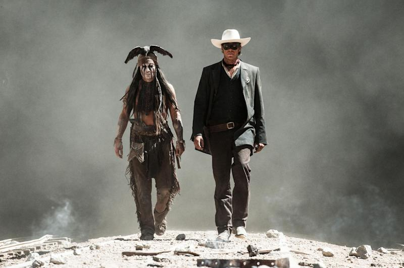 """This undated publicity photo released by Disney/Bruckheimer Films shows, from left, Johnny Depp as Tonto and Armie Hammer as The Lone Ranger, in a scene from the movie, """"The Lone Ranger,"""" directed by Gore Verbinski. The film opens nationwide on July 3, 2013. (AP Photo/Disney/Bruckheimer Films, Peter Mountain)"""