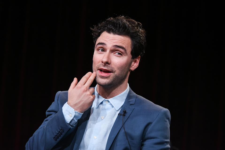 """Aidan Turner speaks on stage during the Masterpiece """"Poldark"""" panel at the PBS 2015 Winter TCA on Monday, Jan. 19, 2015, in Pasadena, Calif. (Photo by Richard Shotwell/Invision/AP)"""
