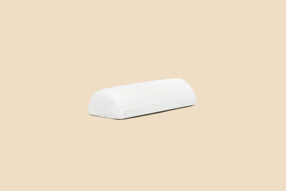 """<p><strong>Coop Home Goods</strong></p><p>coophomegoods.com</p><p><strong>$24.99</strong></p><p><a href=""""https://go.redirectingat.com?id=74968X1596630&url=https%3A%2F%2Fcoophomegoods.com%2Fproducts%2Fadjustable-memory-foam-four-position-support-pillow&sref=https%3A%2F%2Fwww.bestproducts.com%2Ffitness%2Fg37610261%2Fbest-lumbar-support-pillows%2F"""" rel=""""nofollow noopener"""" target=""""_blank"""" data-ylk=""""slk:Shop Now"""" class=""""link rapid-noclick-resp"""">Shop Now</a></p><p>Lumbar rolls that have a half-moon shape like this one from Coop Home Goods are sneakily versatile. You can use them in bed to prop up your knees and ankles or behind the back and neck for added support.</p><p>We recommend this one for bedtime, mainly because it doesn't come equipped with the chair-back strap that others have, and also because its soft, cozy outer material (that also covers <a href=""""https://www.bestproducts.com/home/decor/a34506979/coop-home-goods-eden-pillow-review/"""" rel=""""nofollow noopener"""" target=""""_blank"""" data-ylk=""""slk:the brand's best-selling Eden pillow"""" class=""""link rapid-noclick-resp"""">the brand's best-selling Eden pillow</a>) is really nice to snuggle up with.</p>"""