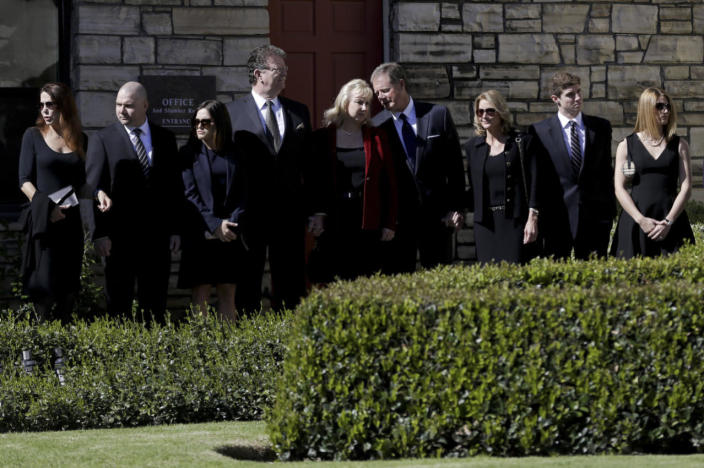 <p>Family members stand outside a funeral home in Santa Monica, Calif., as the casket of Nancy Reagan, widow of former President Ronald Reagan, is transferred for public viewing at the Ronald Reagan Library on March 9. <i>(Photo: Jae C. Hong, Pool/AP)</i></p>