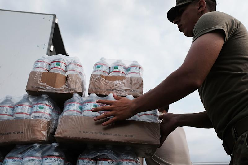 Members of the Texas National Guard prepare to distribute water and emergency meals as Texas slowly moves toward recovery from the devastation of Hurricane Harvey.