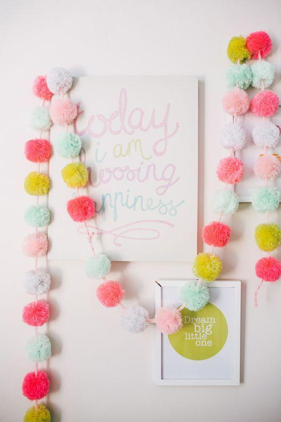 "<p>Brighten up your bedroom or backyard with some pom pom bunting.<i><a href=""https://uk.pinterest.com/pin/378654281151523398/""> [Photo: Pinterest]</a></i></p>"