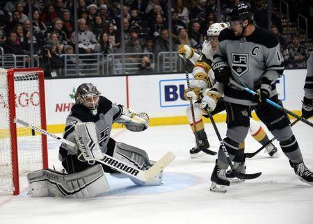 December 8, 2018; Los Angeles, CA, USA; Los Angeles Kings goaltender Jonathan Quick (32) blocks a shot as center Anze Kopitar (11) provides coverage against Vegas Golden Knights center Cody Eakin (21) during the second period at Staples Center. Gary A. Vasquez-USA TODAY Sports