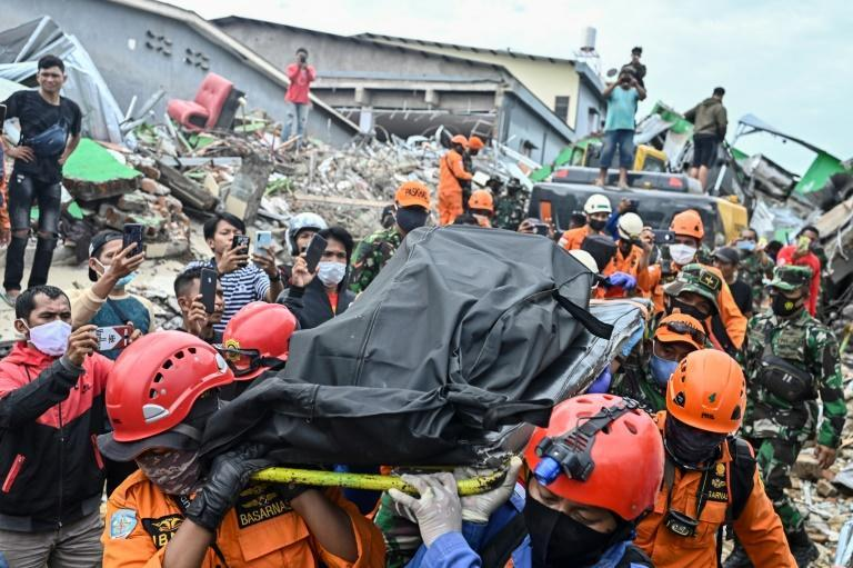Rescuers have been retrieving bodies from the rubble of collapsed buildings