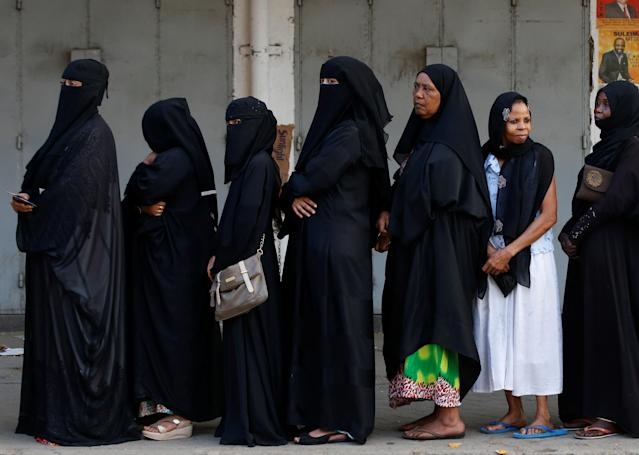 <p>Women queue as they wait for a polling station to open to cast their votes in the presidential election in Mombasa, Kenya, Aug. 8, 2017. (Photo: Siegfried Modola/Reuters) </p>