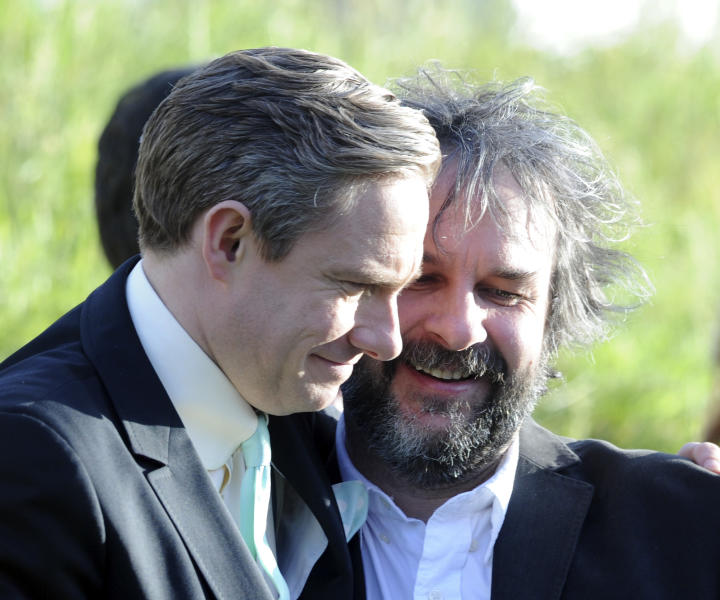"""Cast member Martin Freeman, left, embraces director Peter Jackson at the premiere of """"The Hobbit: An Unexpected Journey,"""" at the Embassy Theatre, in Wellington, New Zealand, Wednesday, Nov. 28, 2012. (AP Photo/SNPA, Ross Setford) NEW ZEALAND OUT"""