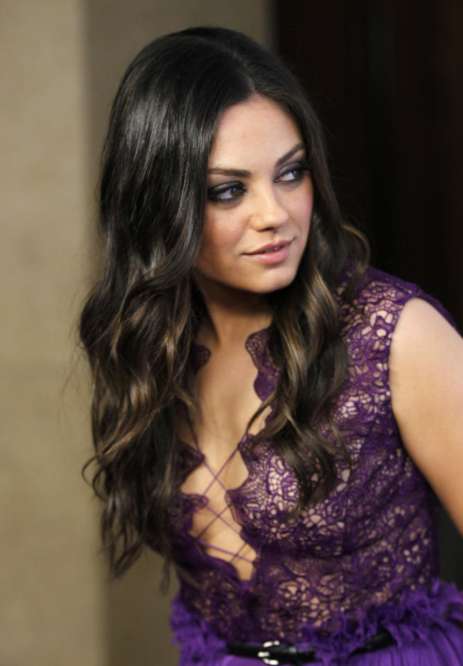 Actress Mila Kunis poses at the benefit gala for the 50th anniversary of St. Jude Children's Research Hospital in Beverly Hills, California January 7, 2012. REUTERS/Danny Moloshok (UNITED STATES - Tags: ENTERTAINMENT)