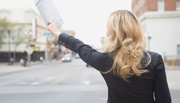 ABTAHG Businesswoman hailing a cab Wall Street wives New York city adult woman hailing a taxi on; the; gobusinesswomenhailing;