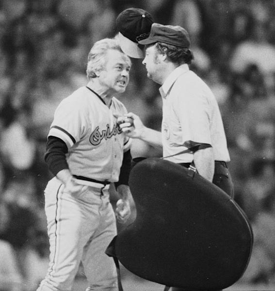 """FILE - In this July 13, 1974 file photo, Baltimore Orioles manager Earl Weaver literally """"flips his lid"""" as he protests a call by home plate umpire Marty Springstead during a baseball game against the Chicago White Sox in Chicago. Weaver, the fiery Hall of Fame manager who won 1,480 games with the Baltimore Orioles, has died, the team announced Saturday, Jan. 19, 2013. He was 82. (AP Photo/File)"""