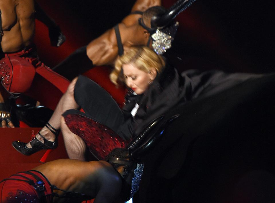 The fall that was felt around the world, Madonna performed her new single 'Living For Love' at the 2015 Brit Awards... though the song was rather overshadowed by an unfortunate wardrobe malfunction involving her cape.