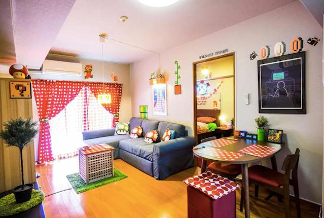 "<p>There's another option for classic video game fans. This ""Super Mario Land"" in Tokyo can be home to you and two friends for $112 a night. The living room, seen here, is of course stocked with a Super Mario-themed gaming area. </p>"