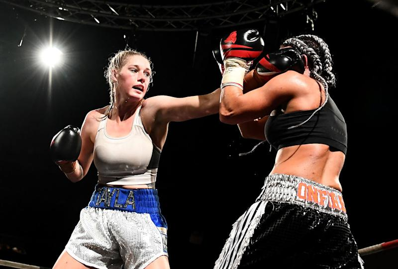 Tayla Harris and Sarah Dwyer exchange punches during the Australian Title Fight between Tayla Harris and Sarah Dwyer at Melbourne Pavillion on November 17, 2018 in Melbourne, Australia. (Photo by Quinn Rooney/Getty Images)