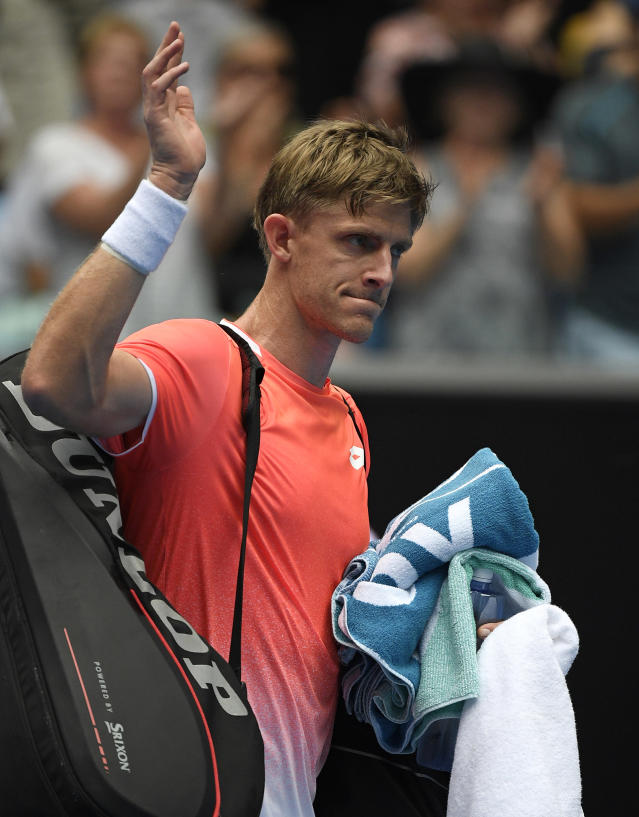 South Africa's Kevin Anderson waves as he leaves the court after losing his second round match to United States' Frances Tiafoe at the Australian Open tennis championships in Melbourne, Australia, Wednesday, Jan. 16, 2019. (AP Photo/Andy Brownbill)