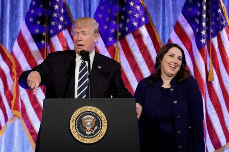 FILE PHOTO: RNC chairwoman Ronna McDaniel reacts next to U.S. President Donald Trump at a fundraising event in New York, U.S., December 2, 2017. REUTERS/Yuri Gripas/File Photo