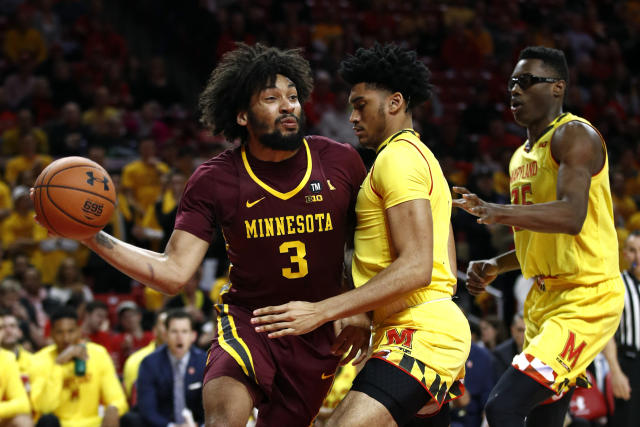 Minnesota forward Jordan Murphy, left, drives past Maryland forwards Ricky Lindo Jr., center, and Jalen Smith in the first half of an NCAA college basketball game, Friday, March 8, 2019, in College Park, Md. (AP Photo/Patrick Semansky)