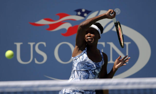 Venus Williams, of the United States, returns a shot against Kimiko Date-Krumm, of Japan, during the opening round of the 2014 U.S. Open tennis tournament, Monday, Aug. 25, 2014, in New York. (AP Photo/Elise Amendola)