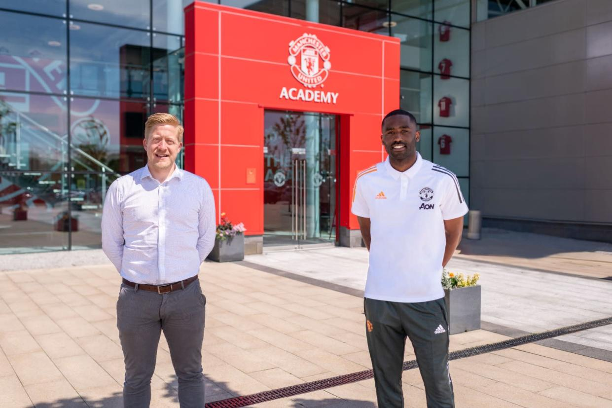 Manchester United head of academy Nick Cox and Justin Cochrane at the training complex (Man Utd)