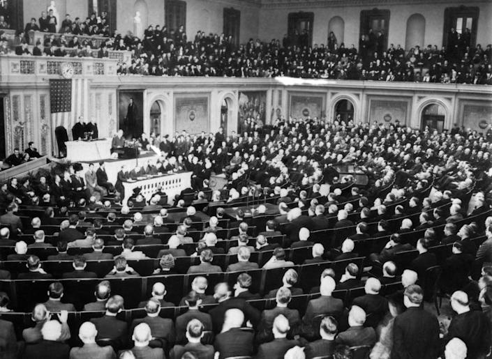 """US President Franklin D. Roosevelt delivers a speech at the opening of the third session of the Seventy-sixth United States Congress in the House chamber of the U.S. Capitol on January 3, 1940 in Washington, DC., United States. - US President Franklin D. Roosevelt asked Congress and the nation to stand united for the promotion of its own """"General welfare and domestic tranquility"""" in order that it may be """"an active factor in seeking the re-establishment of peace"""". (Photo by - / ACME / AFP)        (Photo credit should read -/AFP via Getty Images)"""