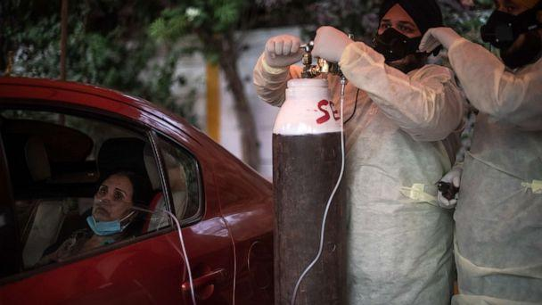 PHOTO: Volunteers treat patients suffering from COVID-19 with free oxygen at a makeshift clinic in a parking lot outside the Gurdwara Damdama Sahib, May 3, 2021, in New Delhi. (Rebecca Conway/Getty Images)