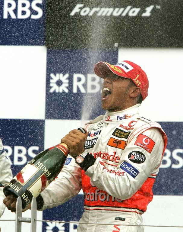 First taste of victory: Lewis Hamilton ceebrating in Montreal in 2007 (AFP/TIMOTHY A. CLARY)