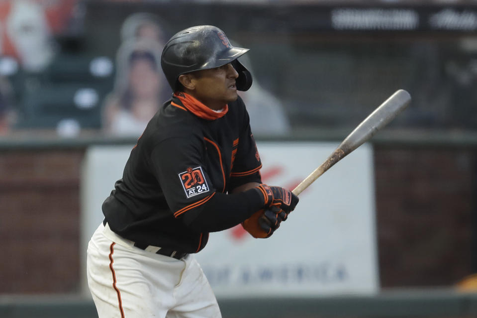 San Francisco Giants' Donovan Solano swings for a two-run single against the Texas Rangers in the third inning of a baseball game Saturday, Aug. 1, 2020, in San Francisco. (AP Photo/Ben Margot)