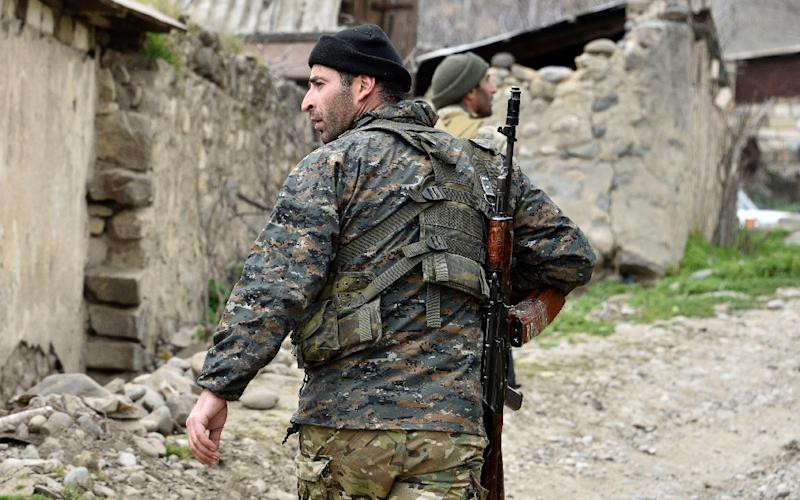 A soldiers from the defense army of Nagorny Karabakh, the breakaway region Azerbaijan has repeatedly threatened to take back by force (AFP Photo/KAREN MINASYAN)