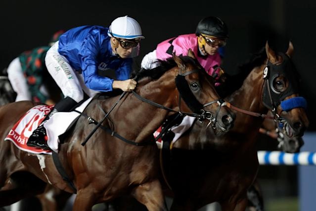 Horse Racing - Dubai World Cup 2018 - Meydan Racecourse, Dubai - United Arab Emirates - March 31, 2018 - Christophe Soumillon rides Thunder Snow from Ireland to the finish line to win the Final Race. REUTERS/Christopher Pike