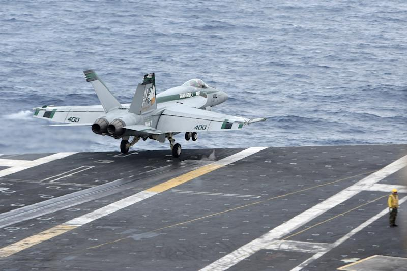 An F/A-18 Super Hornet takes off from the desk of the nuclear-powered USS George Washington (CVN73) off southern coast of Vietnam in South China Sea Saturday, Oct. 20, 2012. A U.S. aircraft carrier group cruised through the disputed South China Sea on Saturday in a show of American power in waters that are fast becoming a focal point of Washington's strategic rivalry with Beijing. (AP Photo/Na Son Nguyen)